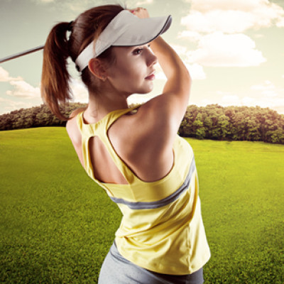 Woman golf player swinging with golf club